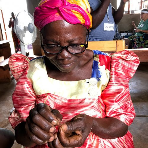 Reading glasses are for more than just reading. This lady can now thread a needle.
