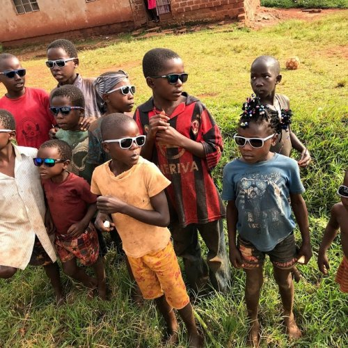 Village children received sunglasses which can help to prevent vision damage